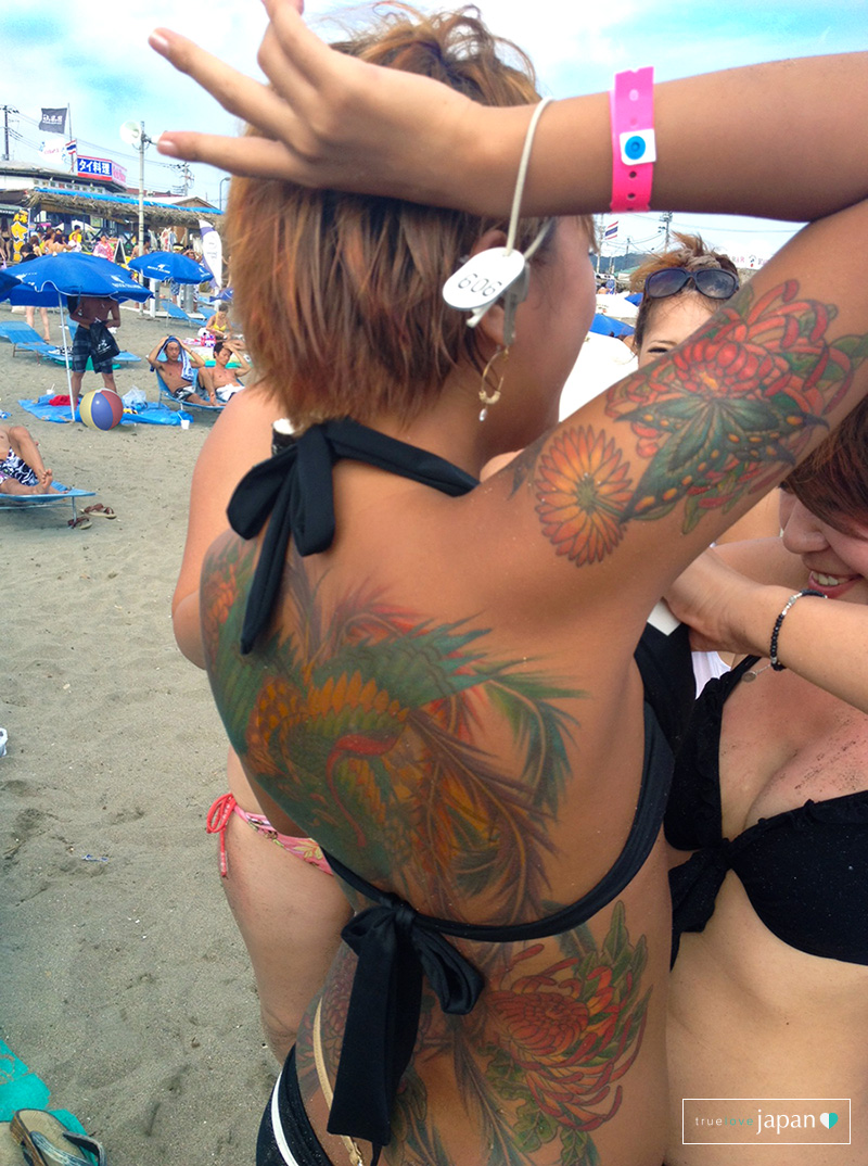 Japanese girl at the beach in Japan with tattoos