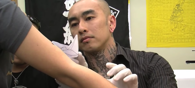 Close view at a tattoo artist in japan