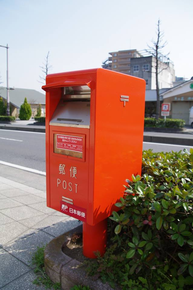 Mail box is red and look like this photo